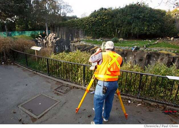 A construction crew takes measurements in front of a lion exhibit for the security glass that will be installed in front of the enclosures. Zoo officials provided a glimpse of the outdoor lion and tiger grotto which is undergoing security upgrades in San Francisco, Calif. on Wednesday, Jan. 2, 2008. The zoo is scheduled to reopen Thursday after the Christmas Day tiger mauling that resulted in one death and two injuries to three zoo visitors.  POOL PHOTO: PAUL CHINN/The Chronicle Photo: PAUL CHINN