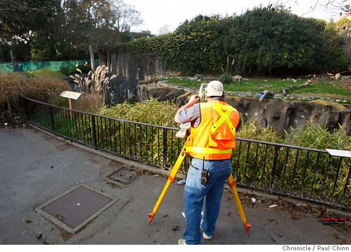 A construction crew takes measurements in front of a lion exhibit for the security glass that will be installed in front of the enclosures. Zoo officials provided a glimpse of the outdoor lion and tiger grotto which is undergoing security upgrades in San Francisco, Calif. on Wednesday, Jan. 2, 2008. The zoo is scheduled to reopen Thursday after the Christmas Day tiger mauling that resulted in one death and two injuries to three zoo visitors. POOL PHOTO: PAUL CHINN/The Chronicle