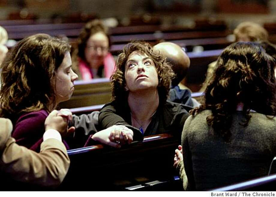 Lisa Finkelstein (center) held hands with friends as a prayer called for the defeat in the courts of Proposition 8. On the eve of the anticipated California Supreme Court ruling on Proposition 8, an interfaith prayer service was held at Grace Cathedral in San Francisco, CA Monday, May 25, 2009. Photo: Brant Ward, The Chronicle