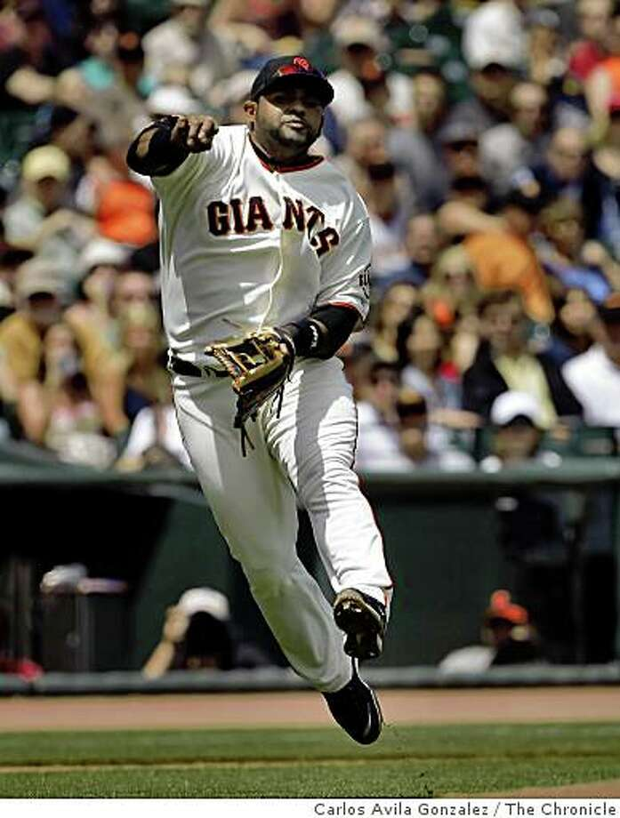Pablo Sandoval throws to first during the game against the Nationals. He has been impressing both his teammates and fans alike with his offense and defense on the field. The San Francisco Giants played the Washington Nationals at AT&T Park in San Francisco, Calif., on Wednesday, May 12, 2009. The Giants lost the game 3-6. Photo: Carlos Avila Gonzalez, The Chronicle