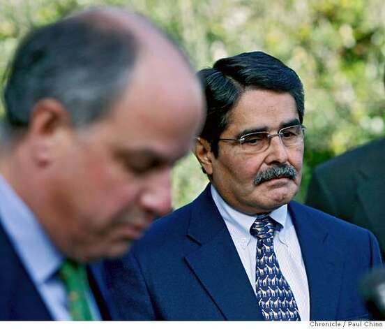 Zoo director Manuel Mollinedo (right) listens as Nick Podell (left), chairman of the board of directors for the Zoological Society, speak to the news media at a press conference in San Francisco, Calif. on Wednesday, Jan. 2, 2008. Plans for security upgrades at the tiger grotto were revealed and when the zoo reopens Thursday, new signage will also be in place reminding visitors to protect the animals.  PAUL CHINN/The Chronicle  **Manuel Mollinedo, Nick Podell Photo: PAUL CHINN