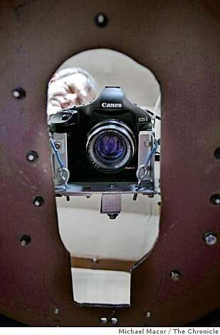 Bob Franklin, checks on his equipment that photographs through the bottom of his aircraft before taking off from the Livermore, Calif. Airport on a mission to photograph over the Valley searching for neglected swimming pools, a breeding ground for mosquitos, on Thursday May 21, 2009. Photo: Michael Macor, The Chronicle