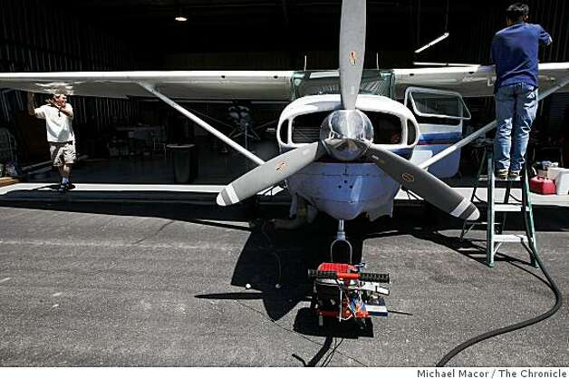Bob Franklin,(left) checks his aircraft before take-off from the Livermore, Calif. Airport on a mission to photograph over the Valley searching for neglected swimming pools, a breeding ground for mosquitos, on Thursday May 21, 2009. Photo: Michael Macor, The Chronicle