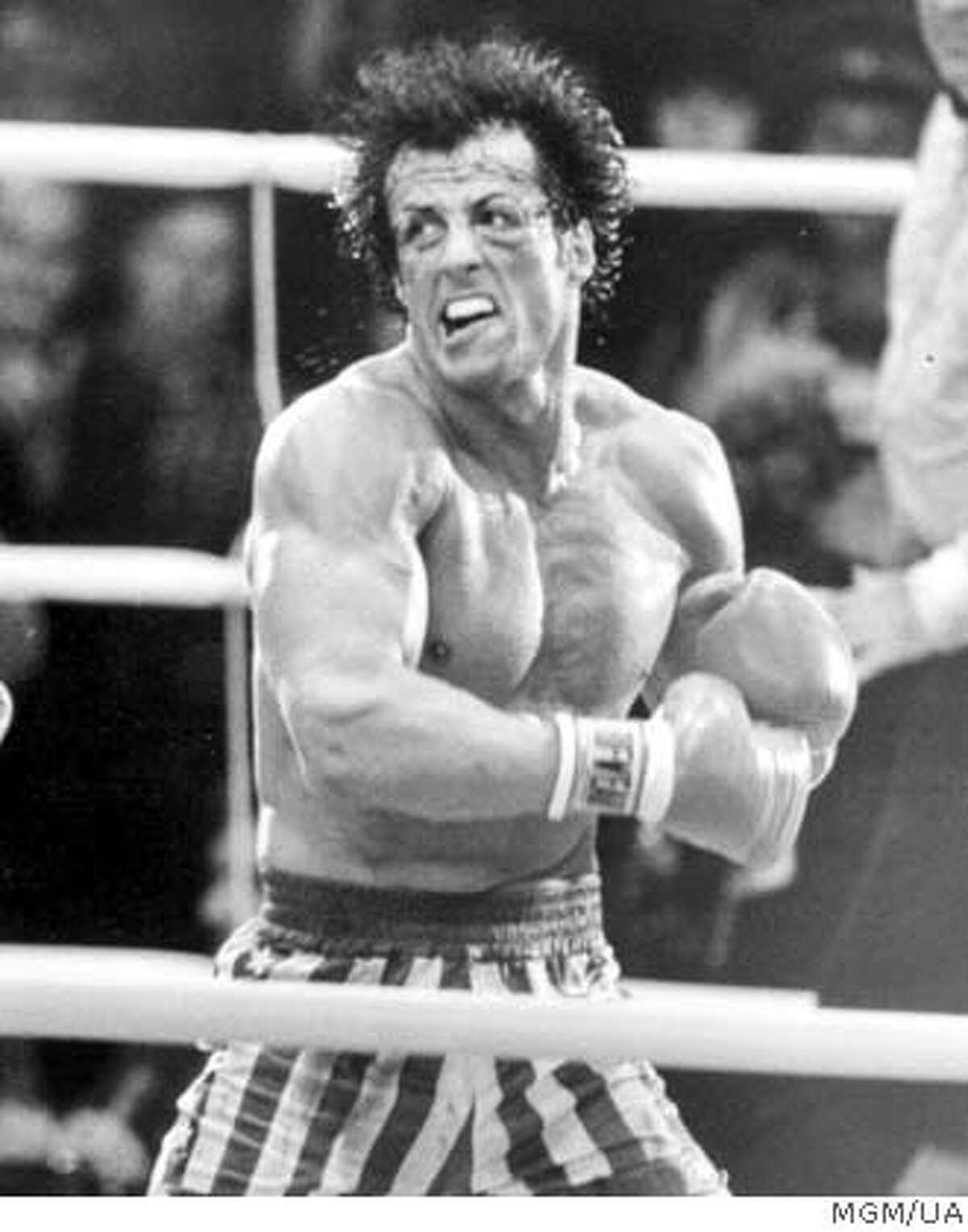 Rocky (Sylvester Stallone) prepares to deliveer a staggering left to the head of Ivan Drago (Dolph Lundgren, left) in Rocky IV. Ran on: 03-06-2005 Rocky IV -- Sylvester Stallone made a career of it.