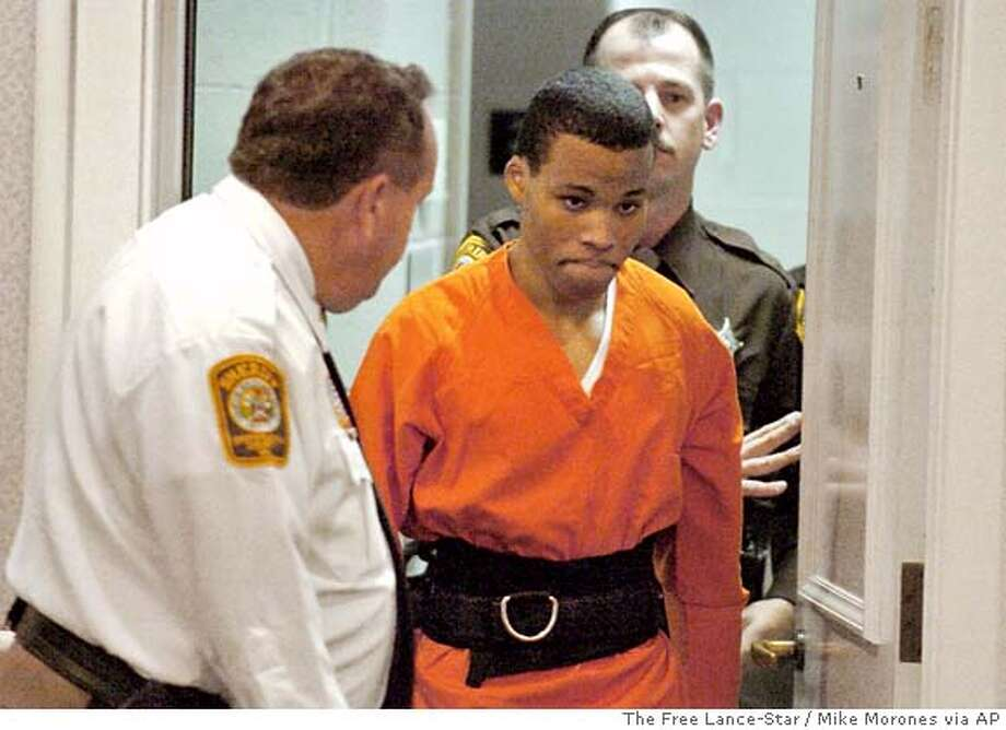 ** FILE ** Sniper suspect Lee Boyd Malvo enters a courtroom in the Spotsylvania, Va., Circuit Court on Tuesday, Oct. 26, 2004. Malvo plead guilty and was sentenced to two life sentences for the murder of Kenneth Bridges and shooting Caroline Seawell in 2002. Since his October 2002 arrest, Lee Boyd Malvo has vacillated between anger at his accomplice in the sniper spree that left 10 people dead and loyalty to the man who accepted him as a son and allegedly brainwashed him into a killing machine. This week, Malvo will give the world an account of where he stands, when he is expected to testify for prosecutors against John Allen Muhammad, the man who molded him into a ruthless 17-year-old sniper. (AP Photo/The Free Lance-Star, Mike Morones) Photo: MIKE MORONES