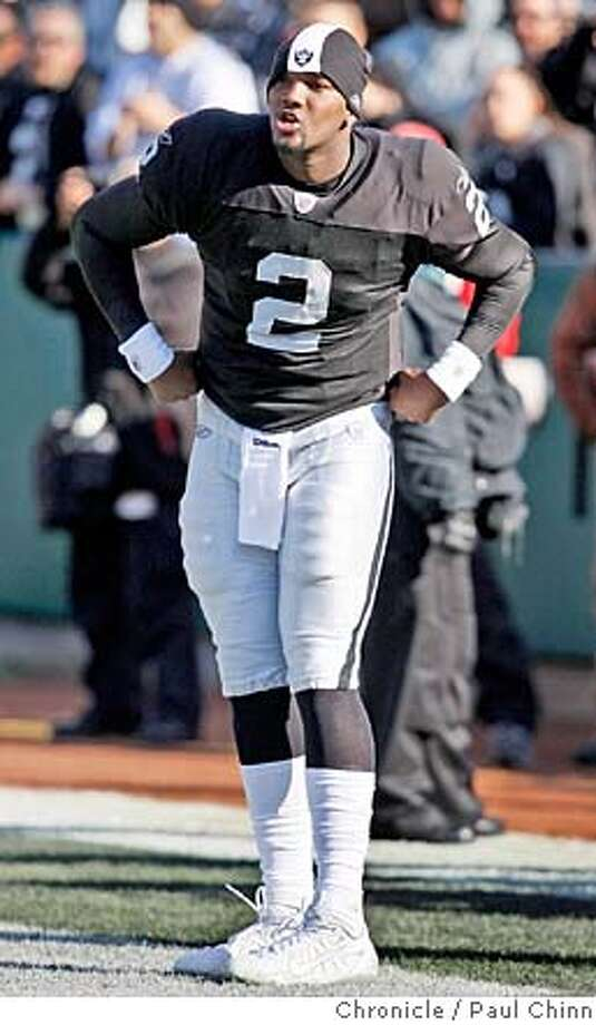 JaMarcus Russell strutted onto the field when he was introduced as the starting QB before the Oakland Raiders vs. San Diego Chargers NFL game at McAfee Coliseum in Oakland, Calif. on Sunday, Dec. 30, 2007. San Diego beat Oakland 30-17.  PAUL CHINN/The Chronicle MANDATORY CREDIT FOR PHOTOGRAPHER AND S.F. CHRONICLE/NO SALES - MAGS OUT Photo: PAUL CHINN