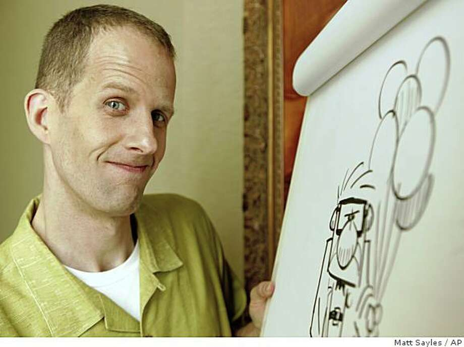 "Pete Docter, director of the animated movie 'Up', poses for photographs during the 62nd International film festival in Cannes, southern France, Wednesday, May 13, 2009. Even after nine hits and four Academy Awards for feature films that include ""WALL-E"" and ""Ratatouille,"" the Pixar Animation gang finally feels it has landed at the grownups' table with ""Up,"" the first animated movie to open the Cannes Film Festival. (AP Photo/Matt Sayles) Photo: Matt Sayles, AP"