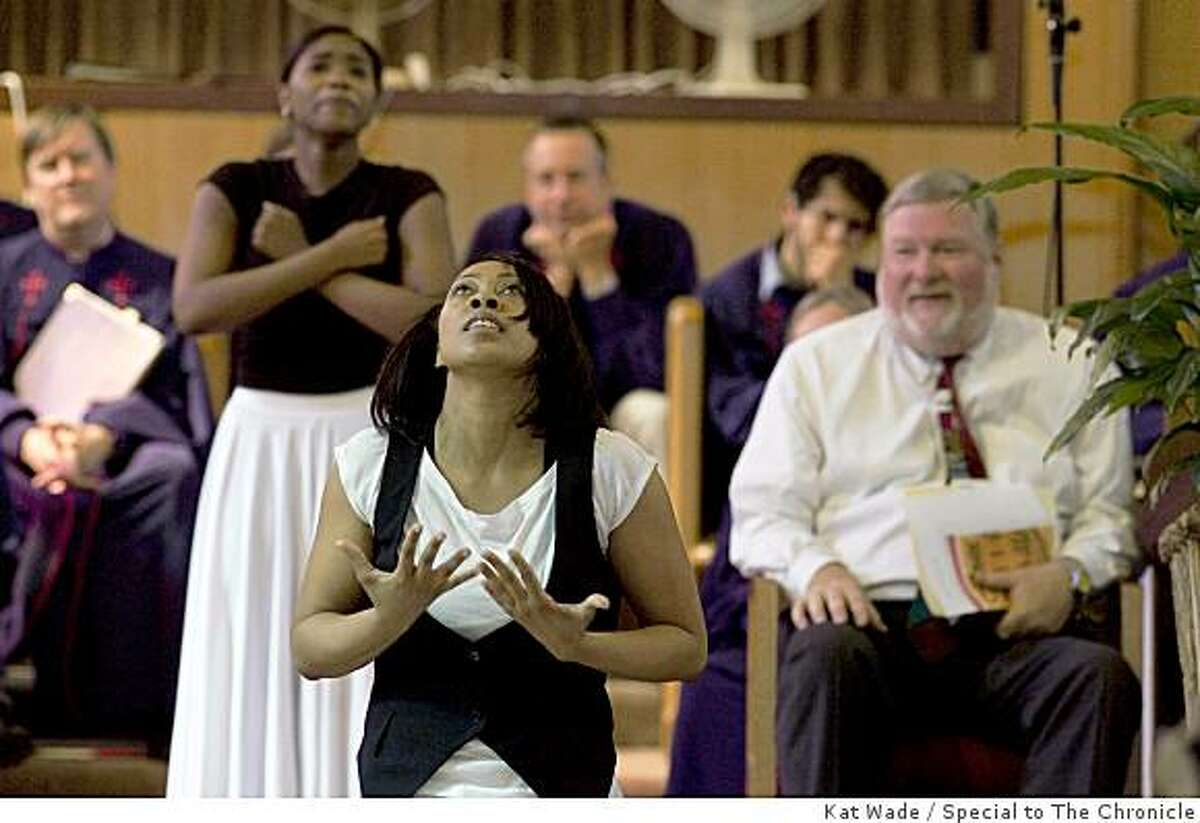 The Piedmont Chancel Choir and Rev. Dr. Bill McNabb, right, from the Piedmont Community Church, watch dancers, Aurielle Trapps, left, and Lisha Bell with Imani Ya Watume perform a devotional dance at Imani Community Church, in Oakland, Calif. on Sunday, May 17, 2009. Photo by Kat Wade / Special to the Chronicle