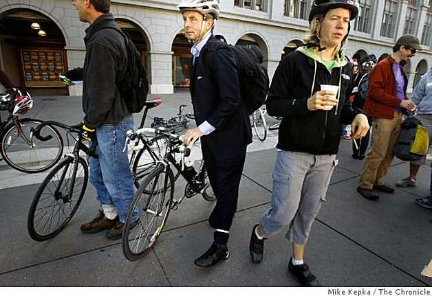 "On the 15th annual Bay Area Bike to Work day, Craig Hartman, an architect from Marin County, heads to work in San Francisco. Hartman says, ""Its about keeping the carbon out of the air and the oxygen in your lungs."" Photo: Mike Kepka, The Chronicle"
