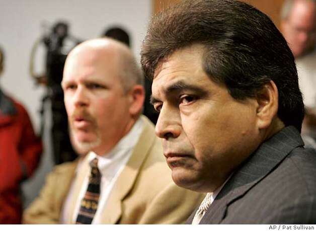 Texas Supreme Court Justice David Medina, right, and his attorney Terry Yates face the media Friday, Jan. 18, 2008, in Houston. Charges were dropped against Medina and his wife related to a fire last summer that burned down their suburban Houston house in the midst of financial troubles. (AP Photo/Pat Sullivan) Photo: Pat Sullivan