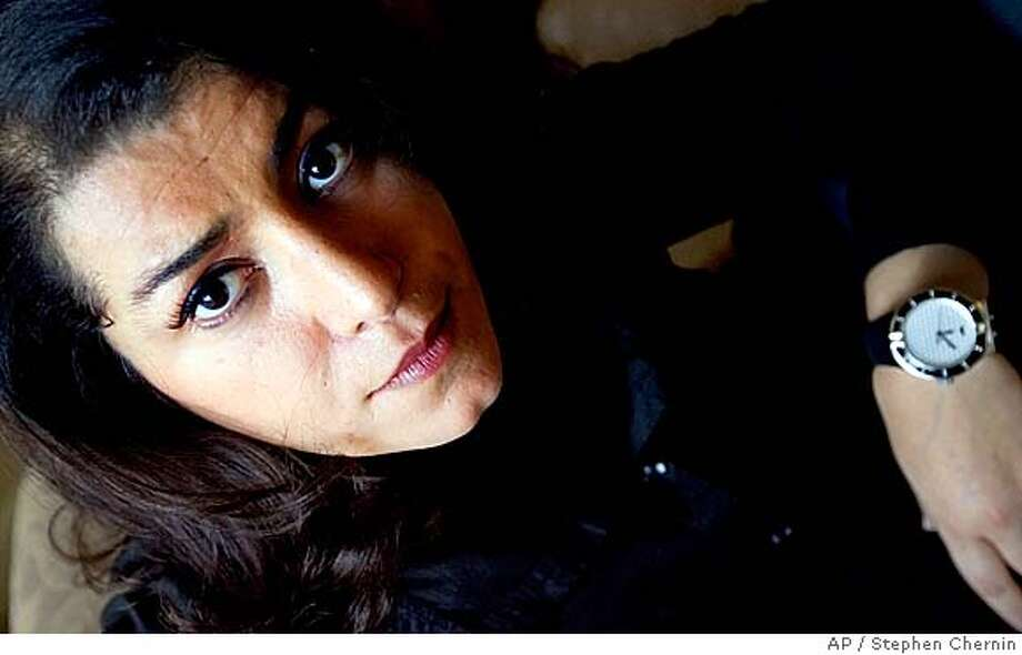 """Author and actress Marjane Satrapi sits for photographs Friday, Dec. 14, 2007 in New York. The movie """"Persepolis,"""" based on the novel of the same name, written by Satrapi, is a hand drawn animated work about a young girl in Iran during the Islamic revolution. (AP Photo/Stephen Chernin) Photo: Stephen Chernin"""