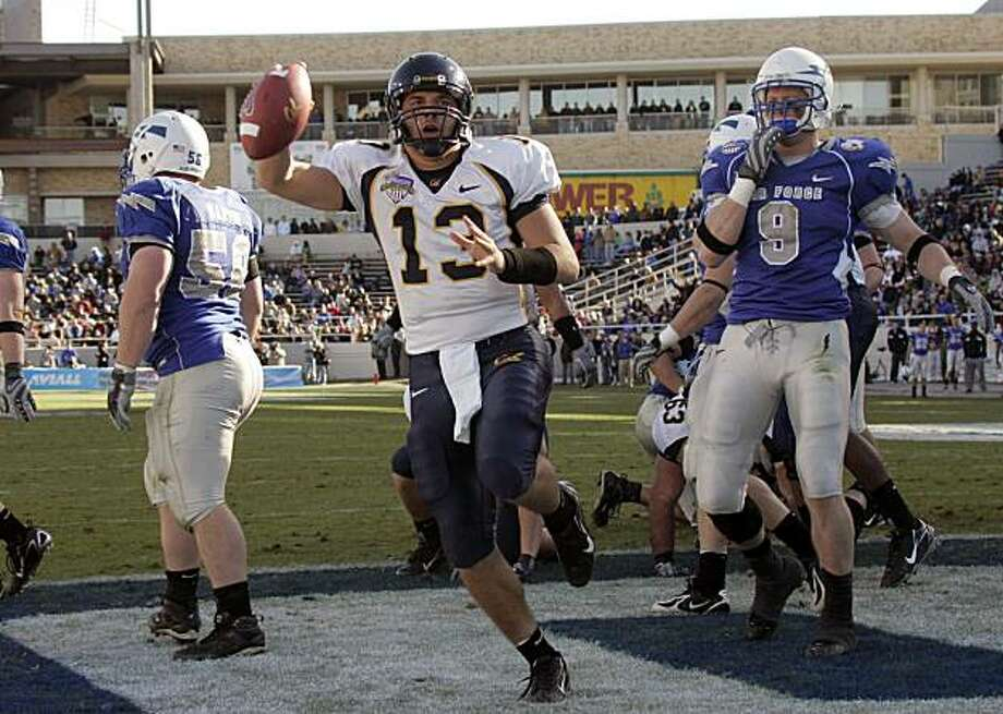 California quarterback Kevin Riley (13) holds the football up after scoring a touchdown in the second half of their football game against Air Force in the Armed Forces Bowl in Fort Worth, Texas, Monday, Dec. 31, 2007. At left is Air Force guard Jared Marvin (56) and lineman John Rabold (9), at right. California won 42-36. (AP Photo/Donna McWilliam) Photo: Donna McWilliam, AP