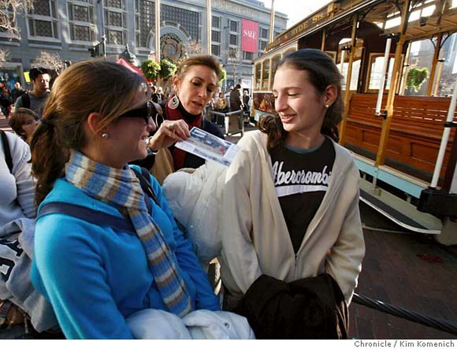 TOURISM06_095_KK.JPG  Maria Virginia De Lima, center, distributes cable car tickets to her second cousin Angela Gers, 18, left and daughter Natalia Rivera, right. Angela is visiting from Florida and Maria Virginia and Natalia are visiting from Cali, Colombia. They are among tourists from around the world who are taking advantage of the dollar's plunge and visiting the United States. Ironically, the economies of tourist destinations like San Francisco stand to benefit from the dollar's drop.  Photo by Kim Komenich/The Chronicle  **Maria Virginia De Lima, Natalia Rivera, Angela Gers MANDATORY CREDIT FOR PHOTOG AND SAN FRANCISCO CHRONICLE. NO SALES- MAGS OUT. Photo: Kim Komenich
