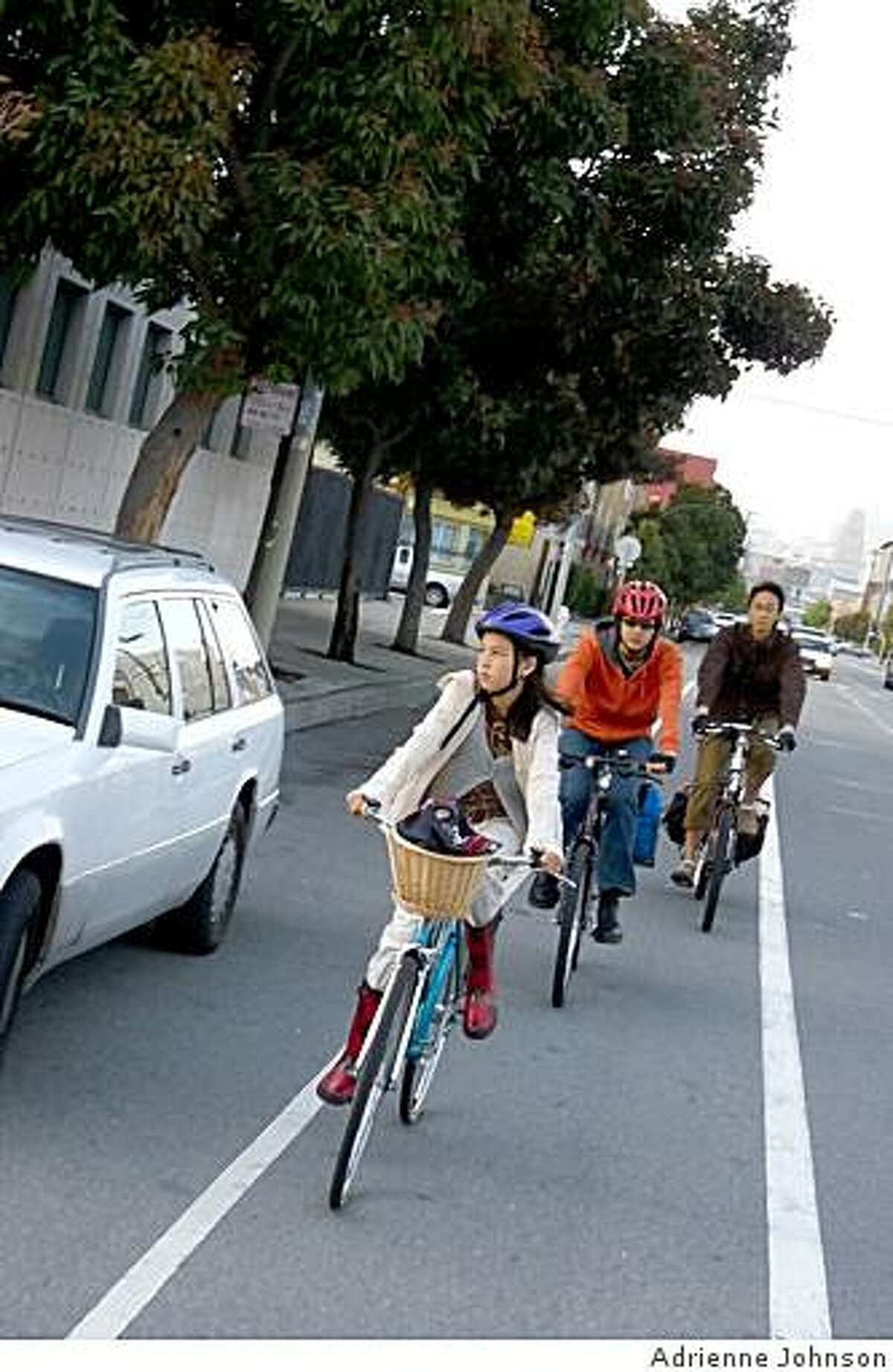 Adrienne Johnson's 10-year-old daughter �na biking on San Francisco's Valencia Street.