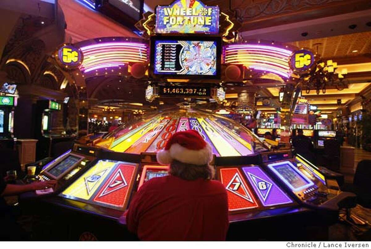 GAMBLING_89184.JPG An unidentified man wearing a Santa Claus hat plays the Wheel of Fortune progressive game with a jackpot of almost 1.5 million dollars. Thunder Valley Casino, east of Sacramento outside Lincoln is the 5th-biggest casino in the United States (including Vegas), The United Auburn Indian Community is about to embark on a new project a hotel tower fashioned after similar Four Season deigns. Once built adding more gaming space and restaurants and the hotel it will stand alone as the largest Northern California's casino. Lance Iversen/San Francisco Chronicle (cq) SUBJECT 12/04/07,in PLACER CO Ca. MANDATORY CREDIT PHOTOG AND SAN FRANCISCO CHRONICLE/NO SALES MAGS OUT