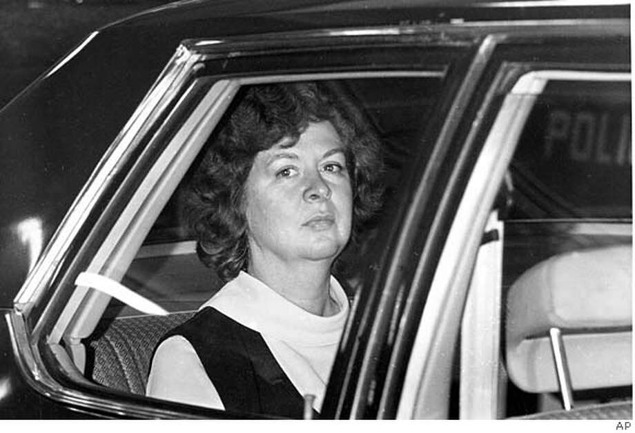 Sara Jane Moore looks out the window of a U.S. marshal's car in San Francisco, seen in this Dec. 16, 1975, file photo, on her way to the federal court where U.S. District Judge Samuel Conti accepted her plea of guilty to the attempted assassination of President Gerald Ford. Photo: JP