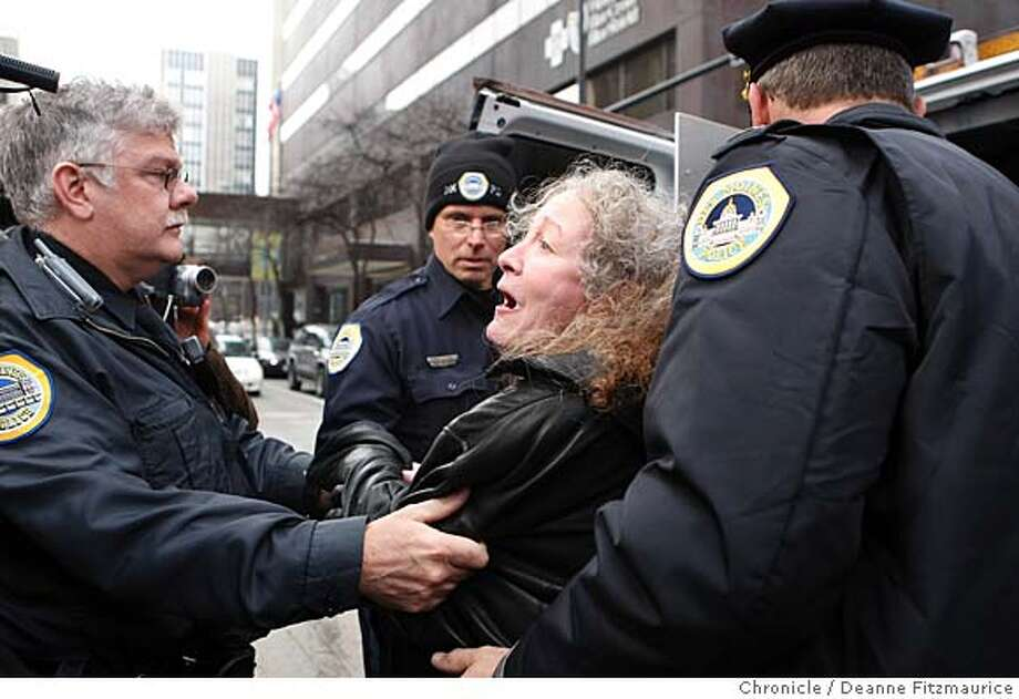 Kathy Kelly, from Chicago, and others were arrested for storming into Mike Huckabee's campaign headquarters forcing the candidate to use another entrance and avoid the confrontation. Republican presidential candidate Mike Huckabee came to his headquarters to meet volunteers who are working the phones on his behalf. Iowans will participate in the first vote of the 2008 presidential election when the Iowa caucus is held on January 3rd. Photographed in Des Moines on 12/31/07. Deanne Fitzmaurice / The Chronicle Photo: Deanne Fitzmaurice