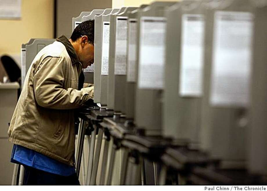 A voter marks his ballot in the basement of City Hall in San Francisco on Tuesday, May 19, 2009. Photo: Paul Chinn, The Chronicle