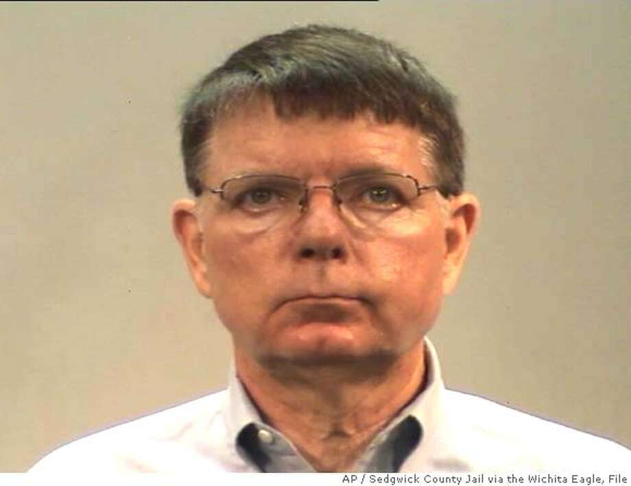 ** FILE *** This booking mug provided by the Sedgwick County Jail via the Wichita Eagle shows Dr. George Tiller, Aug. 3, 2007. A grand jury that was impaneled Jan. 8, 2008 by way of a citizen petition drive is investigating Tiller, a Wichita clinic operator abhorred by anti-abortion activists because he is one of the nation's few physicians who perform late-term abortions. (AP Photo/Sedgwick County Jail via the Wichita Eagle, file) AN AUG. 3, 2007 FILE PHOTO, PHOTO PROVIDED BY THE SEDGWICK COUNTY JAIL VIA THE WICHITA EAGLE, NO SALES Photo: Anonymous