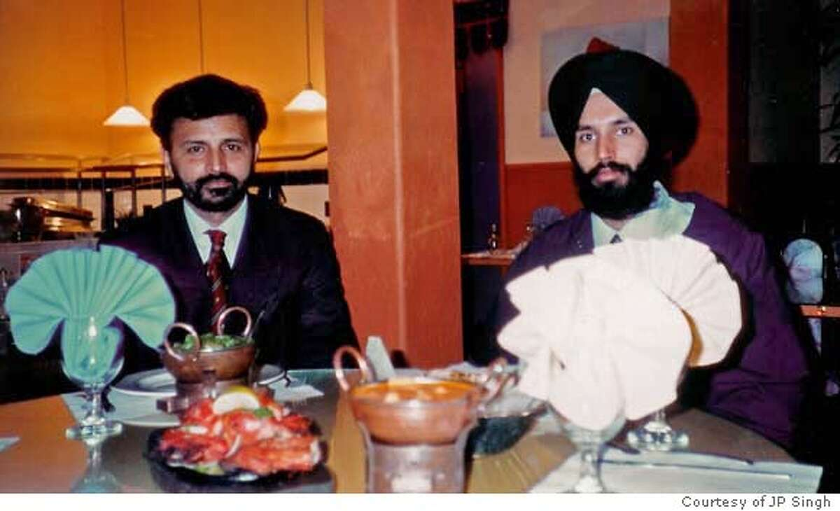 On left Parminder (Pammi) Singh Kalsi and on right Ravinder (Ravi) Singh Kalsi, who were shot and killed in their restaurant, Sahib, in Richmond 12/27/07. Photo was taken in the restaurant. Photo courtesy JP Singh