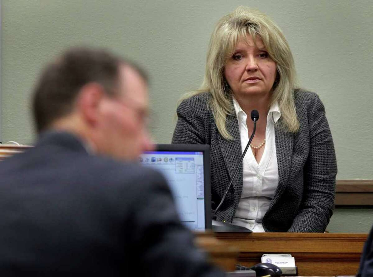 Debbie Cook, a former high official in the Church of Scientology, answers questions from George Spencer, a lawyer for the Church of Scientology, in the 166th Court in the old Bexar County Courthouse on Thursday, Feb. 9, 2012.