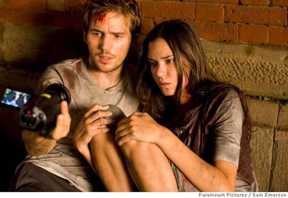 "This undated photo provided by Paramount Pictures shows Michael Stahl-David, left, and Odette Yustman during a scene from ""Cloverfield."" (AP Photo/Paramount Pictures, Sam Emerson) Photo: Sam Emerson"