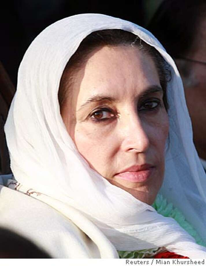 opposition leader Benazir Bhutto attends an election rally in Rawalpindi December 27, 2007, shortly before she was assassinated in a gun and bomb attack. REUTERS/Mian Khursheed (PAKISTAN) Photo: MIAN KHURSHEED