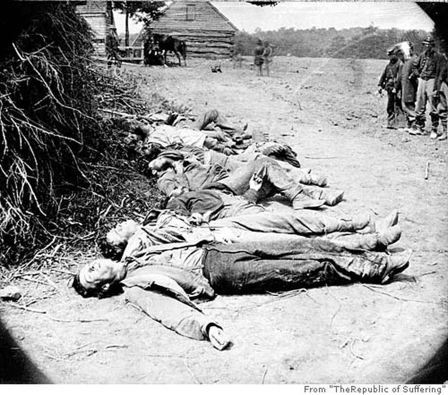 """Scene of Ewell's attack, May 19, 1864, near Spottsylvania [i.e. Spotsylvania] Court House. Dead Confederate soldiers collected for burial. CR: Library of Congress Photo: From """"TheRepublic Of Suffering"""""""