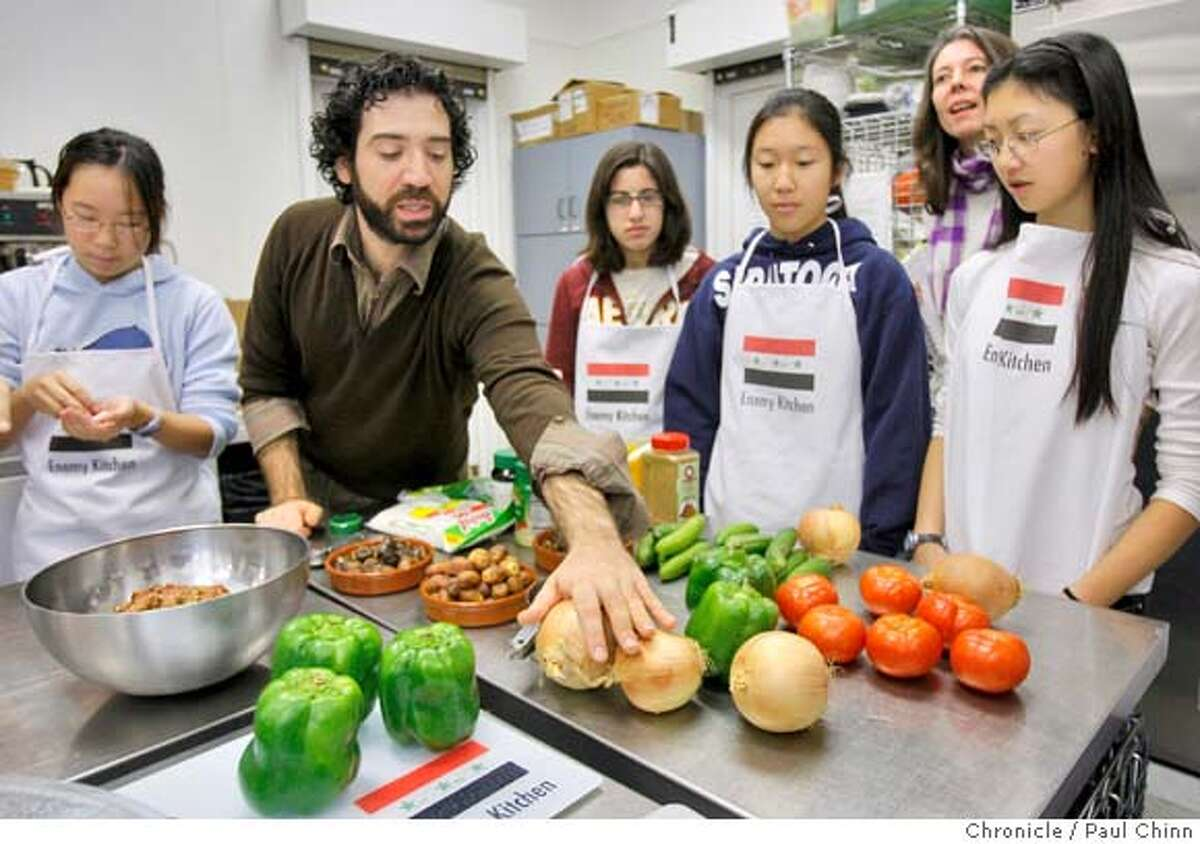 Michael Rakowitz teaches high school students how to make kubba bamia, a traditional Iraqi dish. The Northwestern University art professor presented his Enemy Kitchen project for creative writing students from Saratoga High School at Villa Montalvo in Saratoga, Calif. on Friday, Dec. 21, 2007. The project mixes discussions on Iraqi culture and cuisine that the students helped to prepare. PAUL CHINN/The Chronicle **Michael Rakowitz