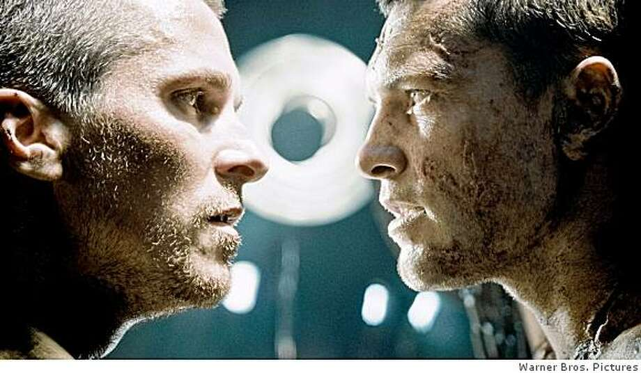 "John Connor and Marcus Wright face off in ""Terminator Salvation."" Photo: Warner Bros. Pictures"
