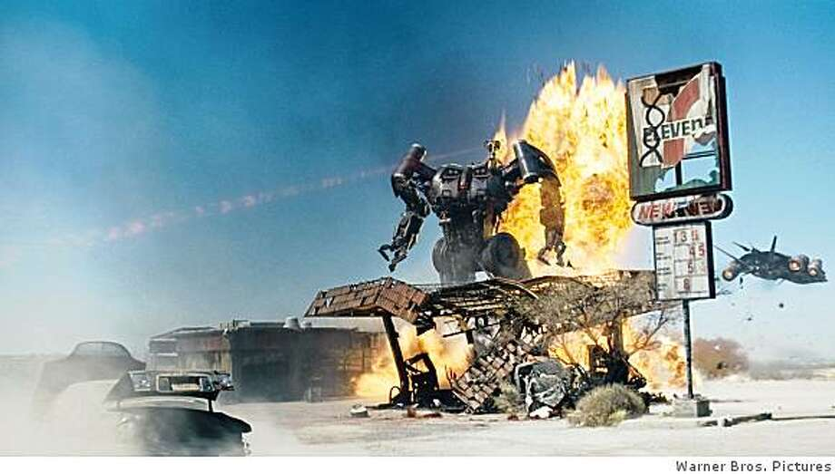 "A Harvester Terminator on the attack with a Transporter Terminator hovering nearby in a scene from Warner Bros. Pictures? action/sci-fi feature ""Terminator Salvation,"" a Warner Bros. Pictures release. The film stars Christian Bale and Sam Worthington. Photo: Warner Bros. Pictures"