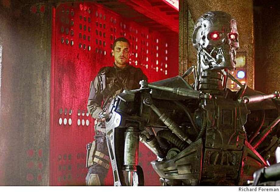 "John Connor, played by actor Christian Bale, sneaks up behind a T-600 Terminator in ""Terminator Salvation."" Photo: Richard Foreman"