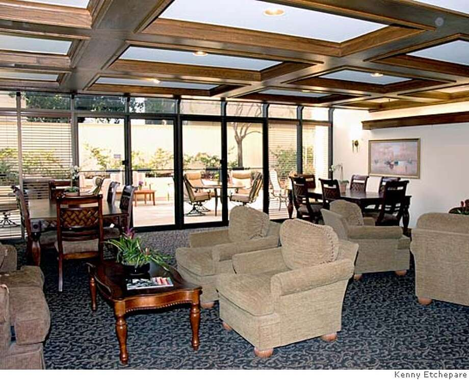 The Juliana Room, one of the common areas of Nazereth Place.  People age 55 and older can buy for fore well below the median price at Nazareth Plaza in San Mateo.  Studios there are selling for $199,000 to $239,950, while one-bedroom condos cost $289,950 to $339,950. Whats the catch? The units arent very big. Photo: Kenny Etchepare