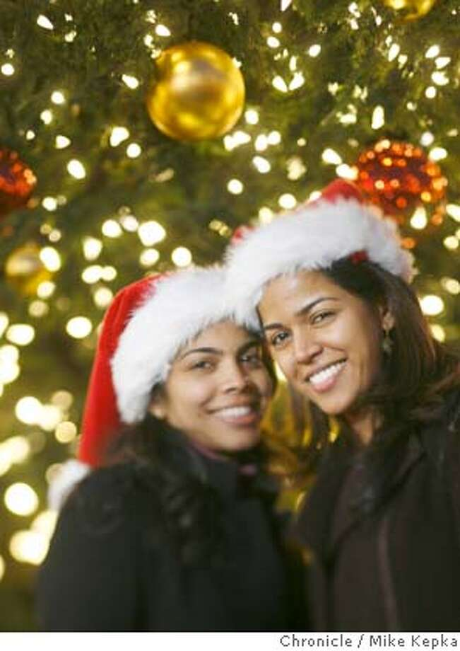 Bay Area families wish the rest of the Bay Area happy holidays.  Sisters Rehana and Christen Wijesingne of San Mateo, Calif. Mike Kepka / The Chronicle Photo taken on 12/22/07, in San Francisco, CA, USA Photo: Mike Kepka