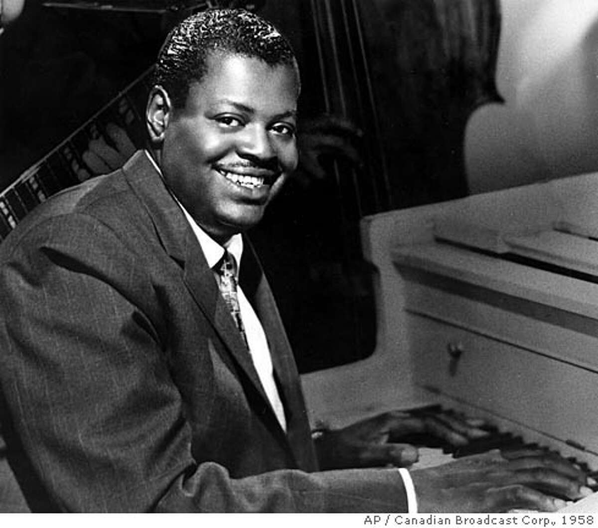 ** FILE ** Oscar Peterson poses in this undated 1958 photo provided by the Canadian Broadcast Corp. Peterson, whose early talent and speedy fingers made him one of the world's best known jazz pianists, died Sunday Dec. 23, 2007 at age 82. (AP Photo/The Canadian Press, CBC)