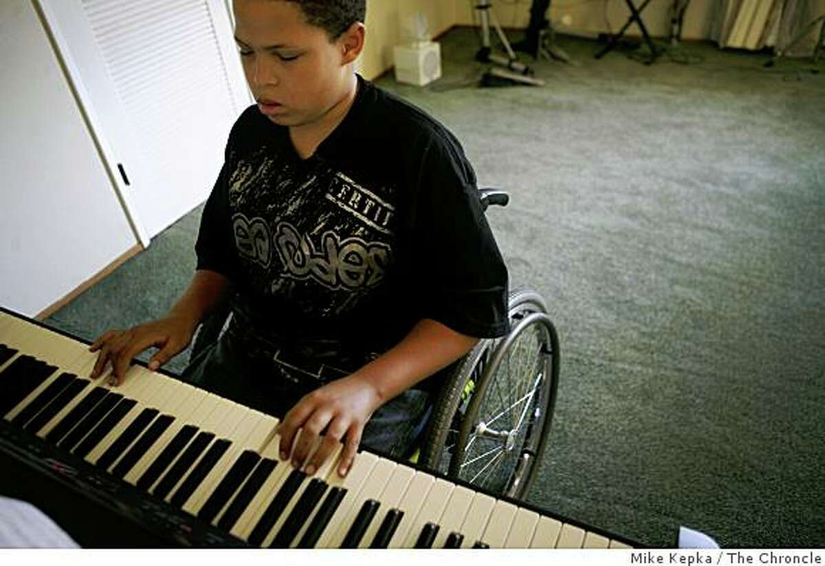 Christopher Rodriguez, 11, shows off a piano piece a favorite piano piece on Thursday July 3, 2008 in Oakland, Calif. Six months ago Rodriguez was shot by a stray bullet that went through the window while he was taking piano lessons. Recently he auditioned his piano skills for the Oakland School of the Arts and was accepted.Photo by Mike Kepka / The Chronicle