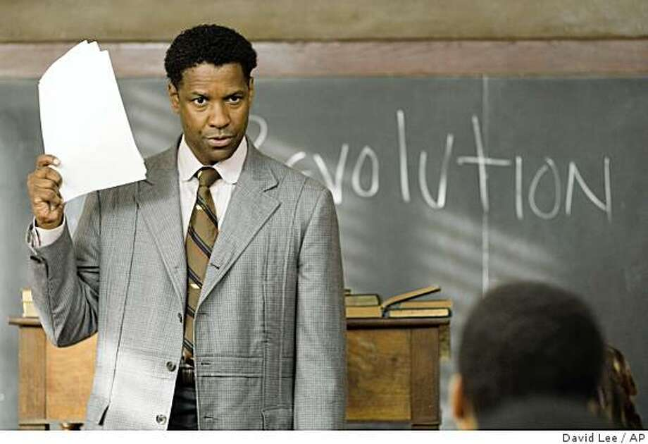"In this image released by The Weinstein Company, actor Denzel Washington is shown in a scene from ""The Great Debaters"". The film was nominated, Thursday, Dec. 13, 2007, for a Golden Globe for Best Motion Picture Drama. The Golden Globes will be held on Jan. 13. (AP Photo/The Weinstein Company, David Lee) ** NO SALES ** Ran on: 12-25-2007 Denzel Washington plays real-life educator Melvin B. Tolson in &quo;The Great Debaters,&quo; in which students from all-black Wiley College in Texas take on Harvard. Photo: David Lee, AP"