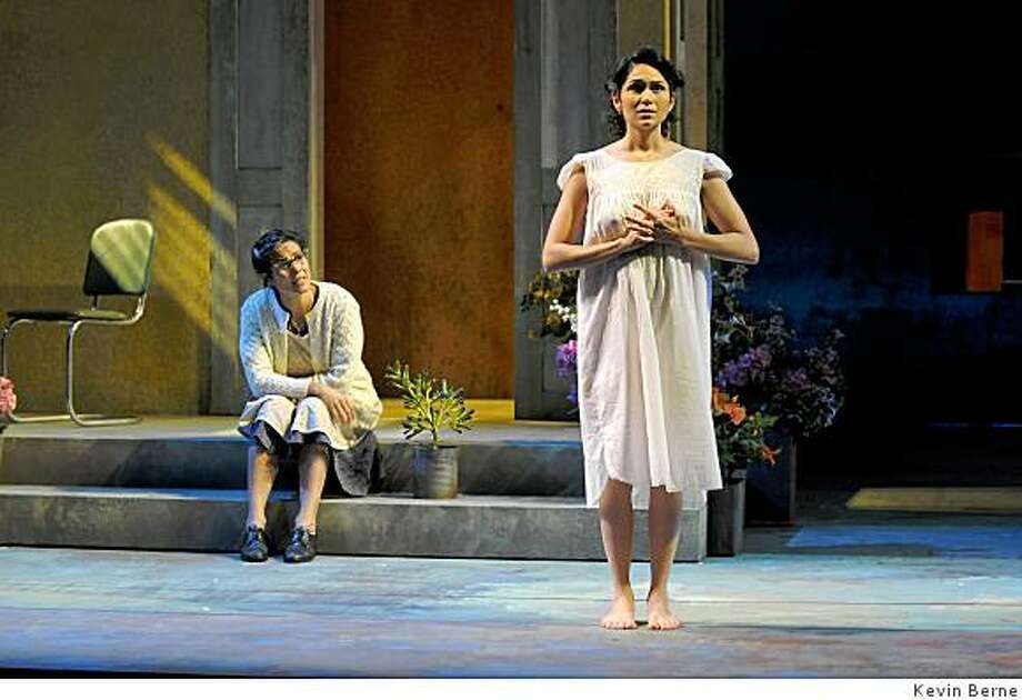 """Rachel Ticotin (left) as Dona (with a tilde over the n) Milla discusses love problems with her daughter Flora (Lela Loren) in Jose (accent / over the e) Rivera's """"Boleros for the Disenchanted"""" Photo: Kevin Berne"""