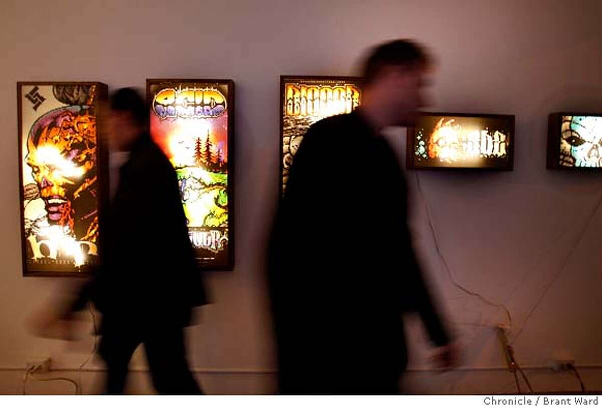Curators at the 20 goto 10 art gallery on Geary Street finish their installation of computer scroller ANSI artwork set to open Saturday January 12. {By Brant Ward/San Francisco Chronicle}