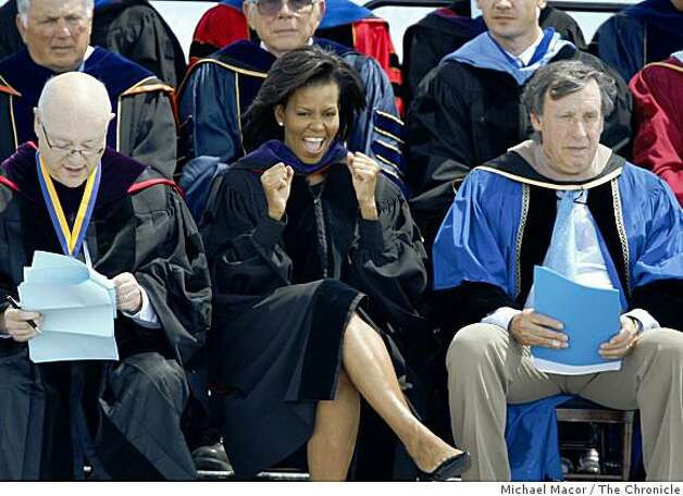 First Lady Michelle Obama cheers on the graduates before she delivers the commencement speech to the first full graduating class of UC Merced on Saturday, May 16, 2009 in Merced, Calif. Mark Yudof, (left) President, University of California and Richard Blum, Chairman, Regents University of California, join the First Lady on stage. Photo: Michael Macor, The Chronicle