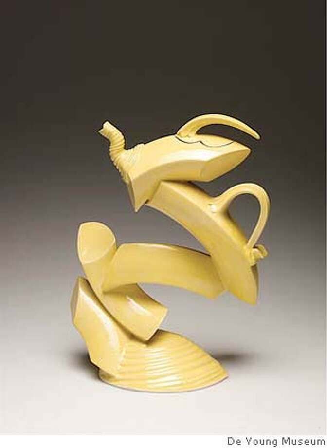 Ray Bubb, Lemon Yellow Triangular Cross-Section Reassembled Hollow Ring Teapot, 2000. Glazed stoneware. 15 x 12 x 5 in. courtesy of the de Young Museum Photo: Courtesy Of The De Young Museum