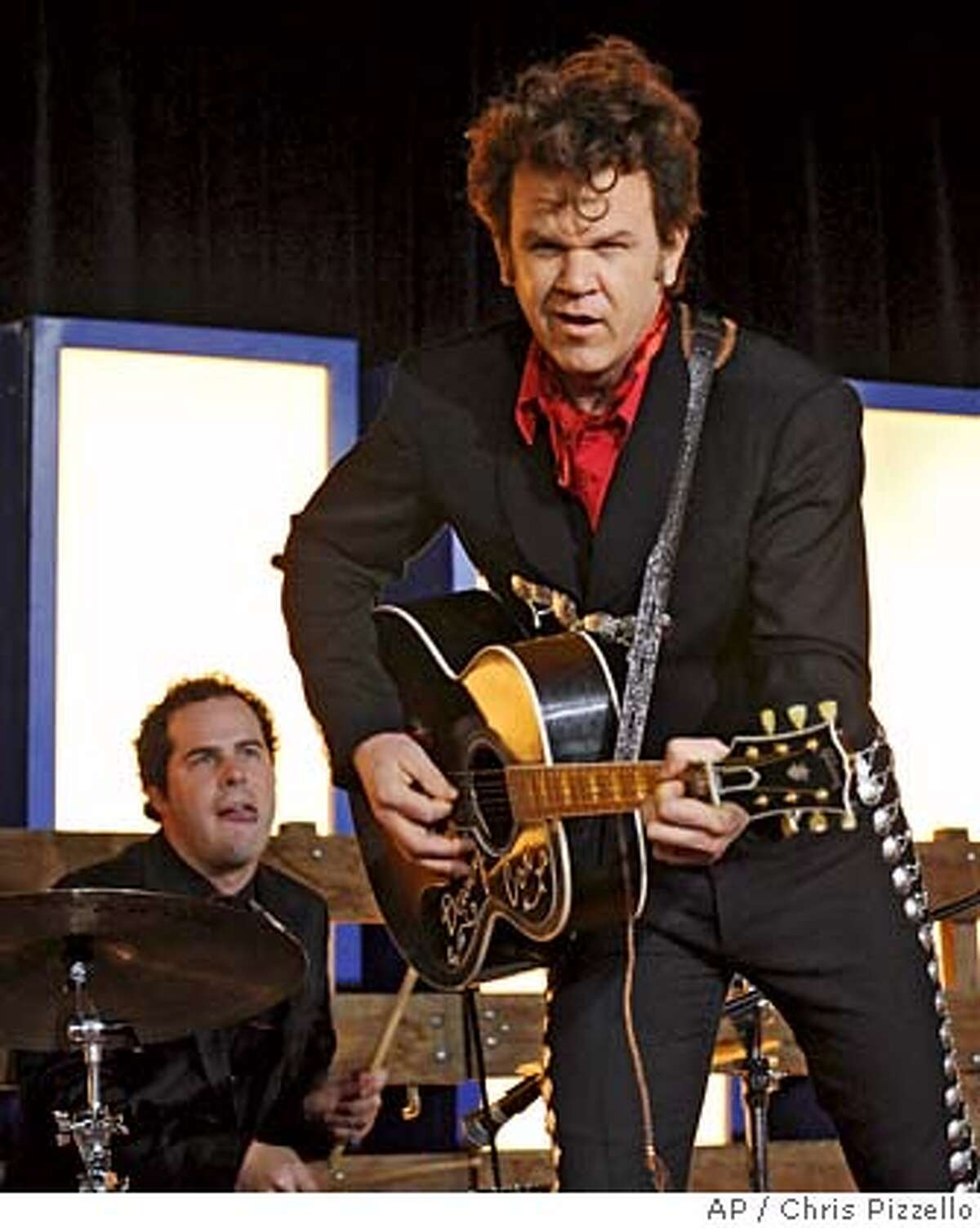 **FILE** Actor John C. Reilly, right, performs as musician Dewey Cox at the premiere of
