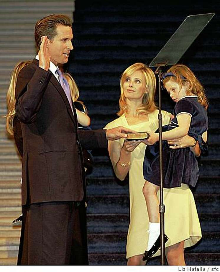 NEWSOM09_OATH_070_LH.JPG Mayor Gavin Newsom takes his oath of office with William Newsom at right in the city hall rotunda.  Jennifer Siebel beside him who is carrying Gavin's niece Talitha Callan.Liz Hafalia/The Chronicle/San Francisco/1/9/08**Jennifer Siebel, Talitha Callan   cq Photo: Liz Hafalia, Sfc