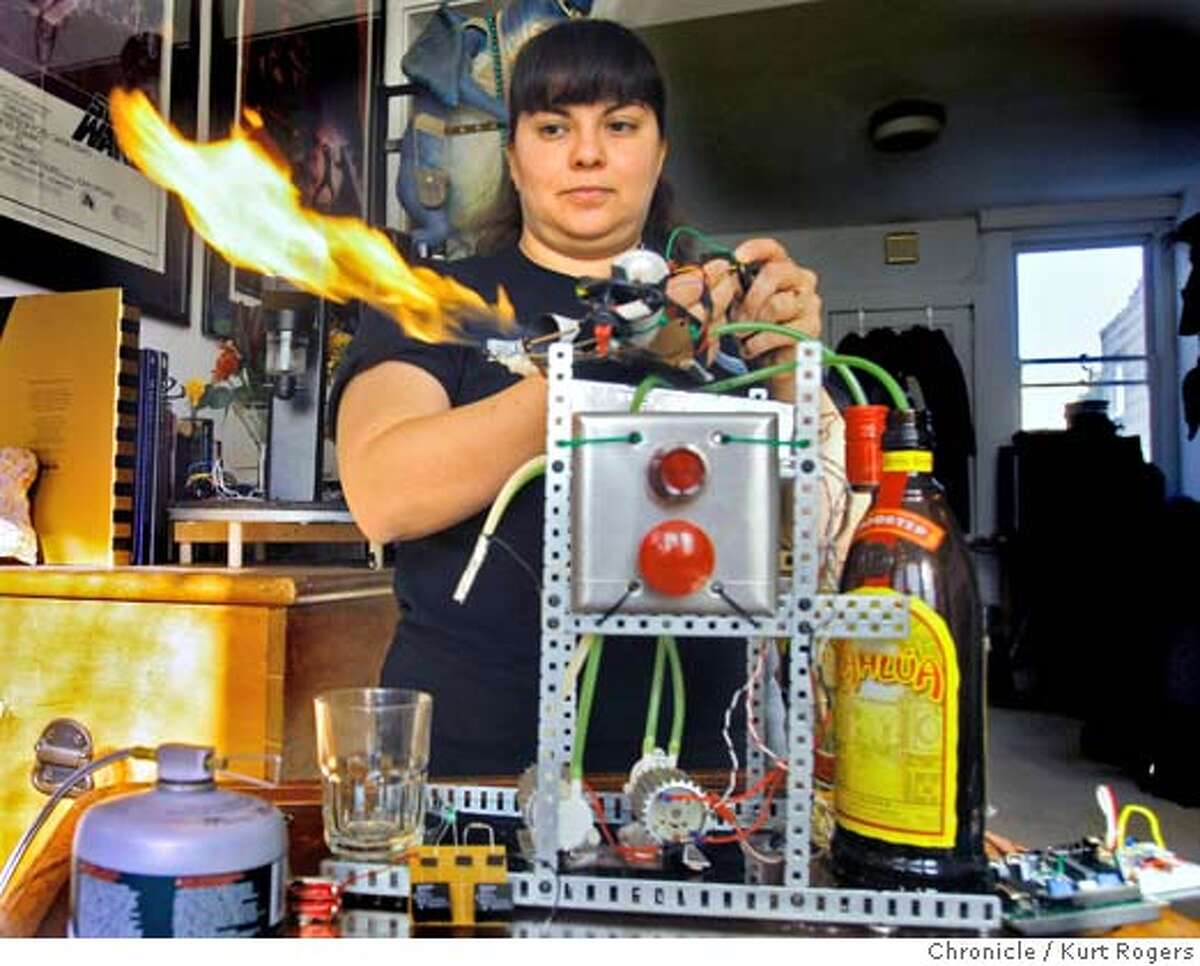 Simone Davalos who is a robot builder she came up with a robot that makes mixed coffee drinks then flames them. ROBOFAMILY_0068_KR.jpg Kurt Rogers / The Chronicle Photo taken on 11/13/07, in San Francisco, CA, USA Ran on: 12-09-2007 Ran on: 12-09-2007