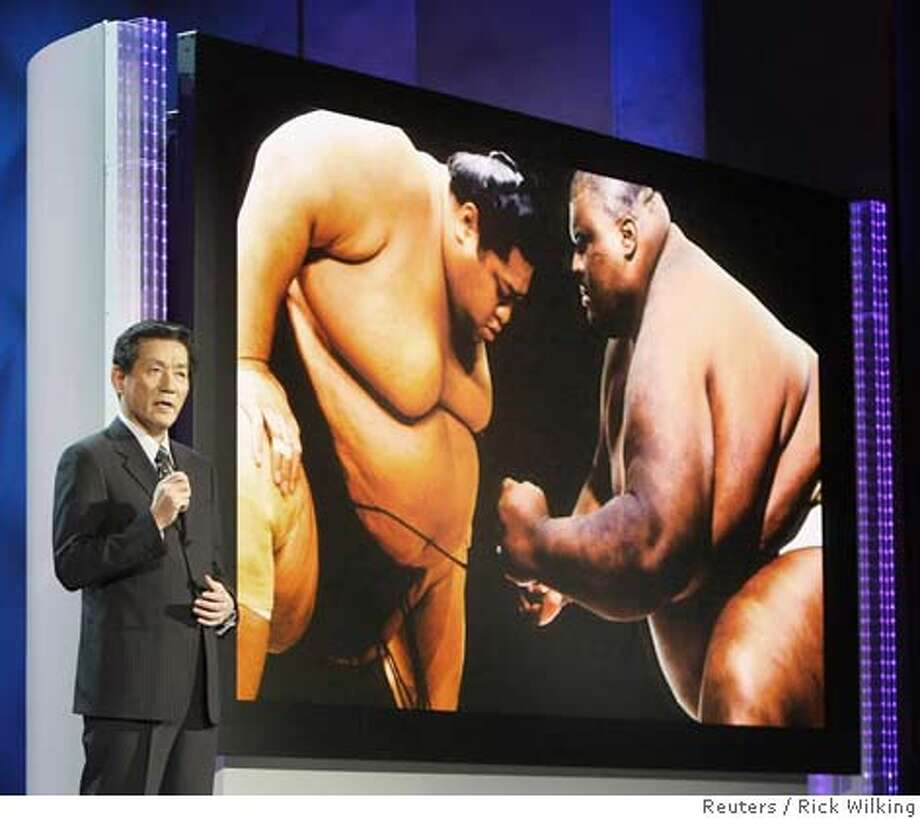 Toshihiro Sakamoto, president of Panasonic AVC Networks introduces what the company calls the world's largest flat panel television at 150-inch at his keynote address at the Consumer Electronics Show CES in Las Vegas, Nevada January 7, 2008. The TV tops the Panasonic brand maker's 103-inch plasma TV released last year. REUTERS/Rick Wilking (UNITED STATES) Photo: RICK WILKING