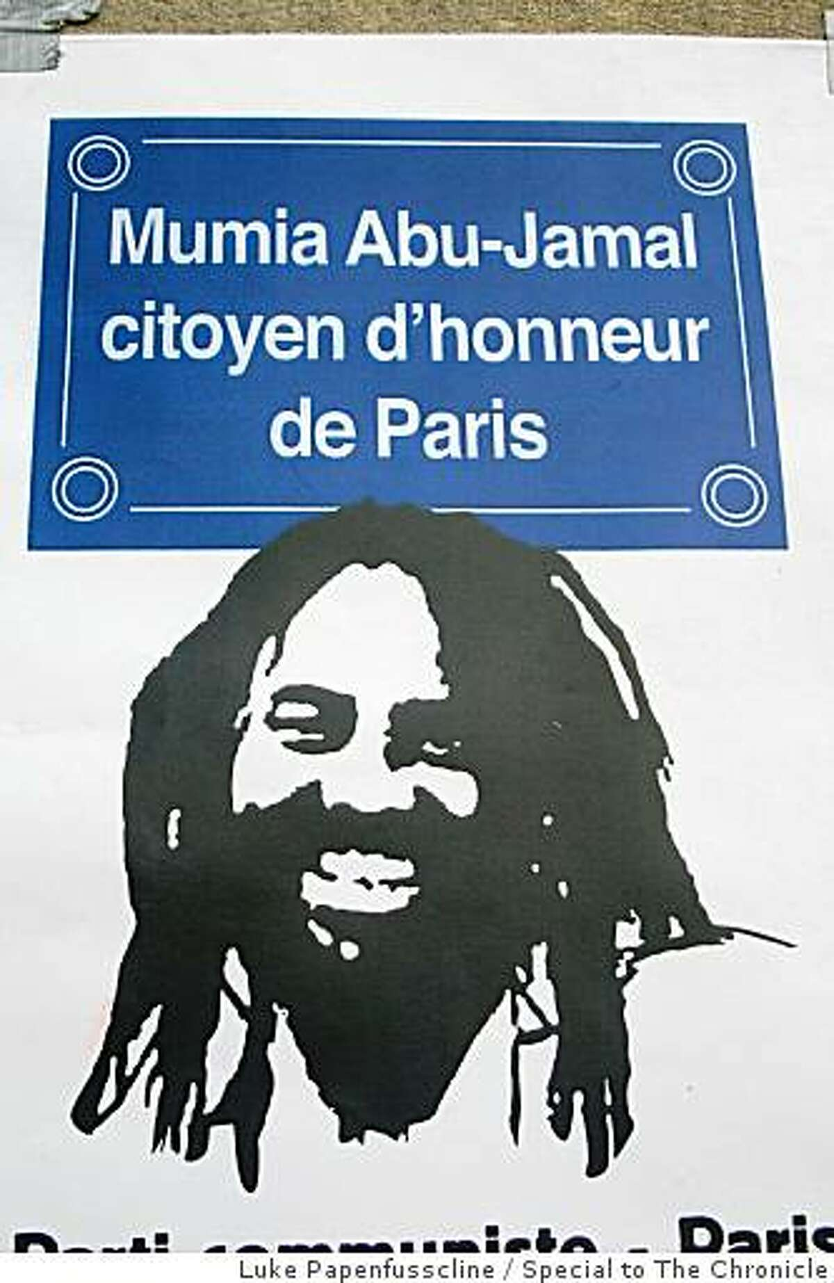 Mumia Abu-Jamal poster on Paris wall that says he is an honorary citizen of Paris.
