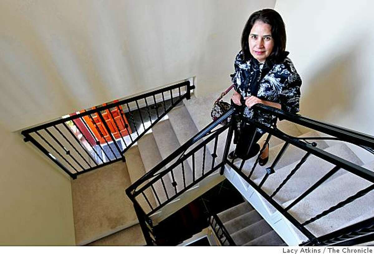 Realtor Pinky Sohal with Legacy Real Estate shows off a 6,000 square foot home in the Oakland Hills that after 14 months on the market was sold when the price dropped under one million dollars, Wed. May 14, 2009, in Oakland, Calif.
