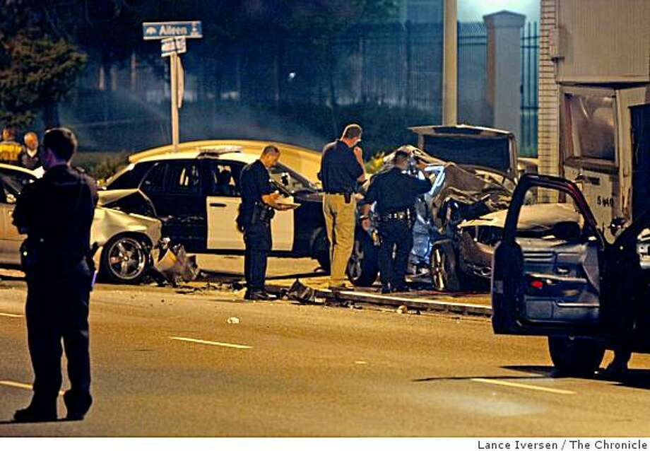 A car carrying four suspects in a Berkeley homicide slammed into a vehicle in North Oakland while fleeing from police Saturday evening, killing two people - one a motorist, the other a pedestrian - in a horrific chain-reaction crash on MLK at Aileen streets in Berkeley Saturday, May 16, 2009. Photo: Lance Iversen, The Chronicle