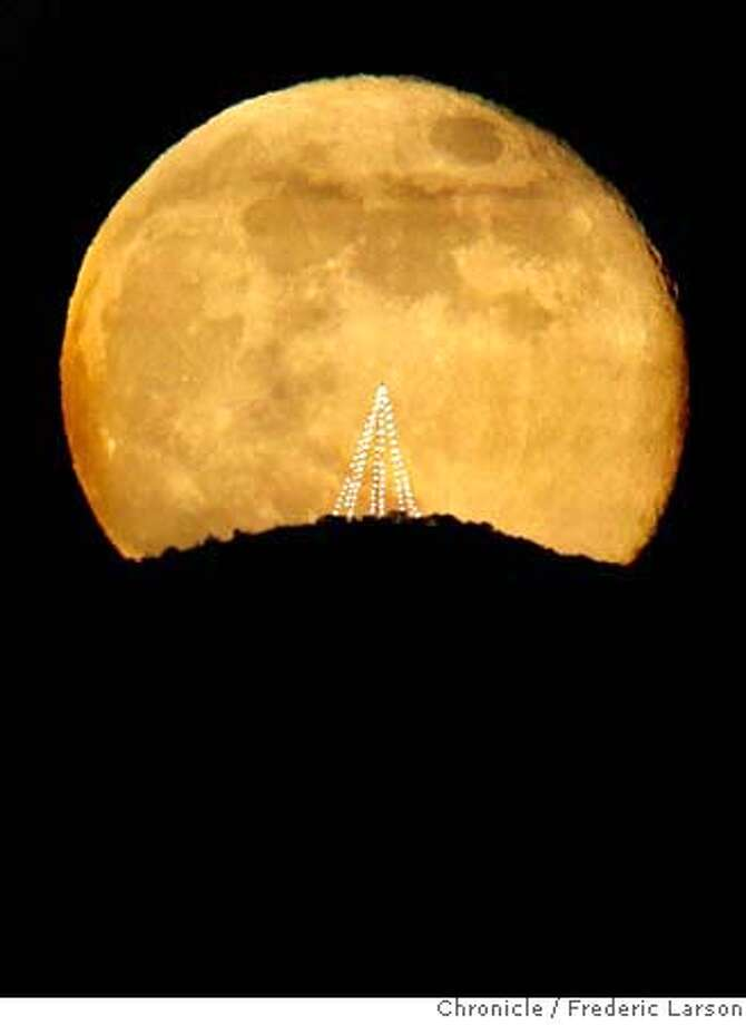 A full moon appears over Angel Island in San Francisco in early December 2006. Photo: Frederic Larson