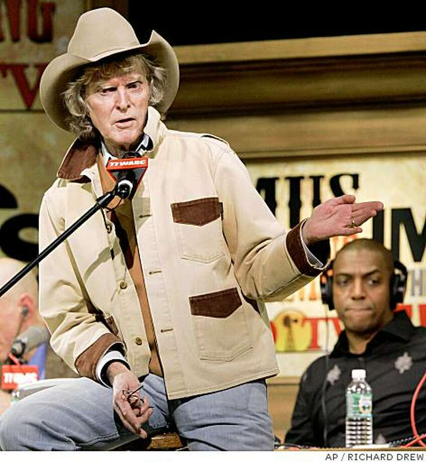 Don Imus, left, delivers remarks at the beginning of his program at New York's Town Hall Monday morning Dec. 3, 2007. Imus returned to the airwaves Monday eight months after he was fired for a racially charged remark about the Rutgers women's basketball team, and introduced a new cast that included Tony Powell, right, one of two black comedians. (AP Photo/Richard Drew) Photo: RICHARD DREW, AP